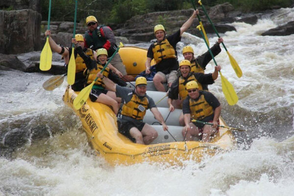 Penobscot rafting smiling group hold on