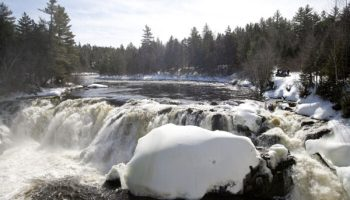 Snowmobiling to Grand Falls on the Dead River