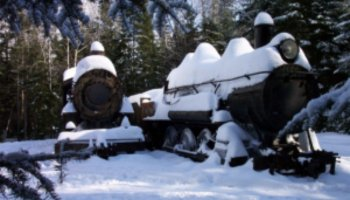 Snowmobiling to Maine's Abandoned Eagle Lake Trains- History & Routes