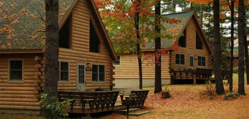 Cabins in the woods with fall foliage in Maine