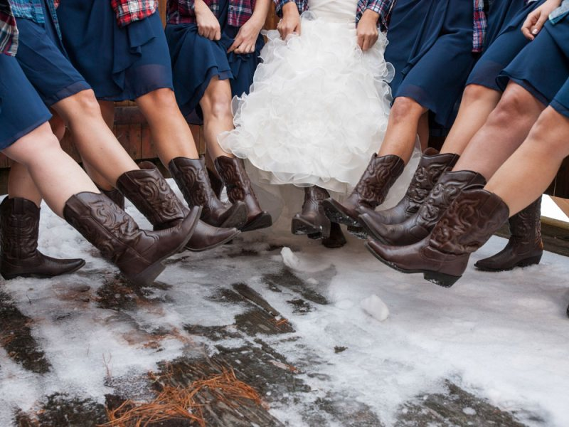 Bridal party in cowboy boots - unique Maine winter wedding destination in The Forks