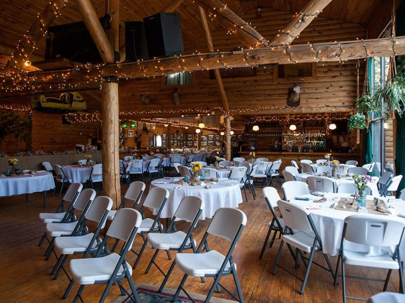 rustic lodge wedding Maine - ceremony and reception decorated with lights
