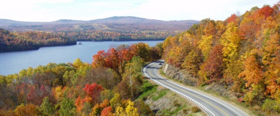 Scenic drive with fall leaves and the Kennebec River on Route 201 in The Forks, Maine
