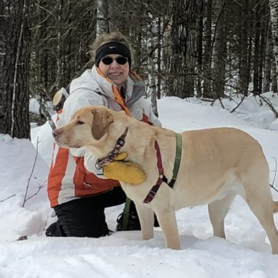 Laura and Dog Hiking in Maine in the Winter