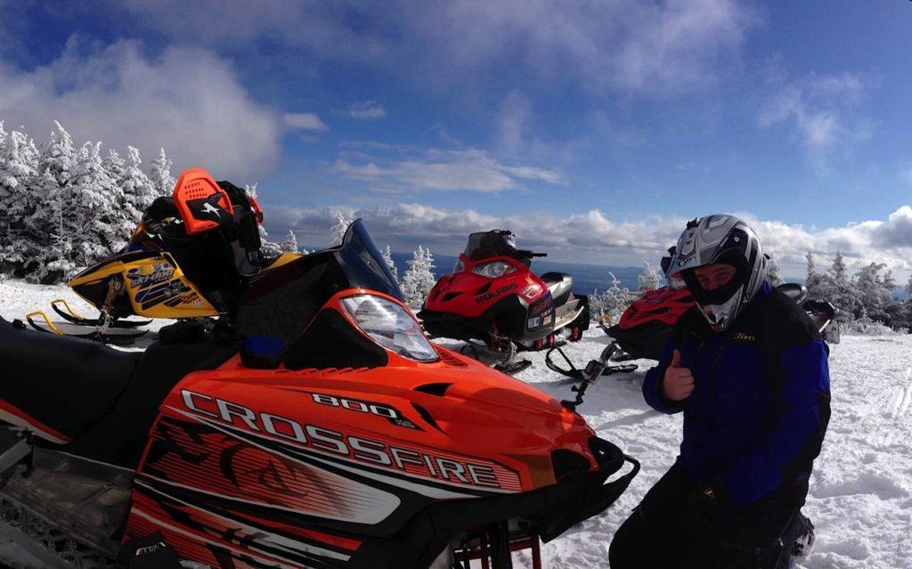 Snowmobiling is the best part of a Maine winter vacation