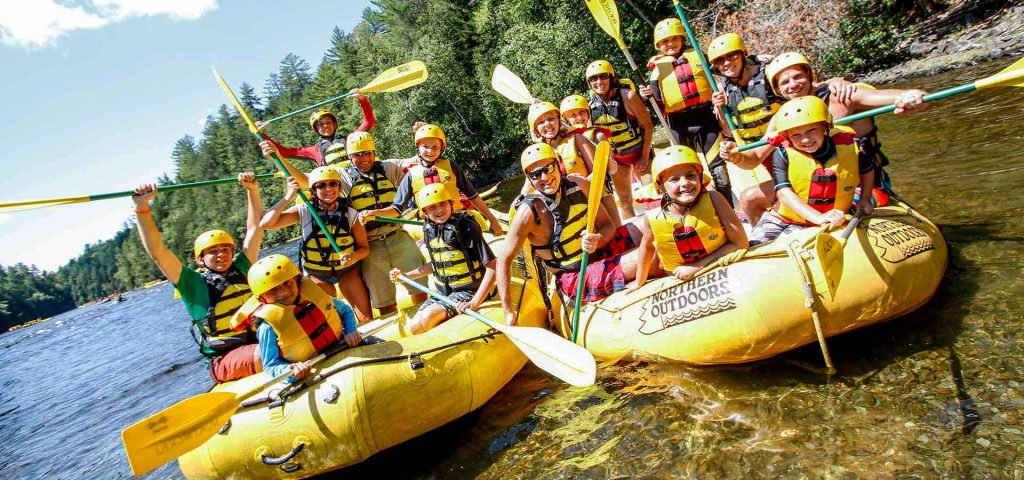 Family rafting in Maine on an active family reunion