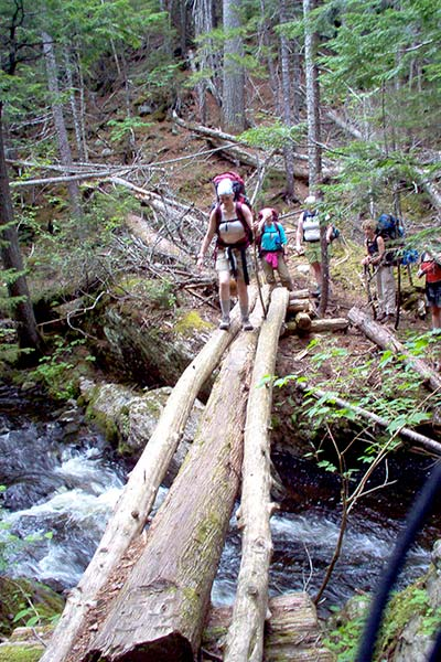 Family hiking in the woods in Maine - Northern Outdoors