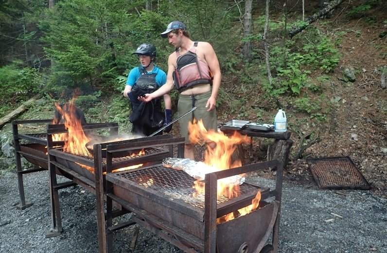 rafting guides cooking lunch