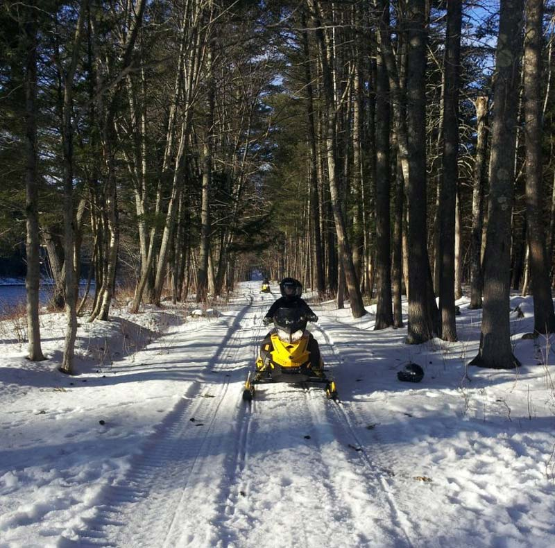 Snowmobiling the River Trail to Grand Falls