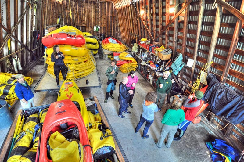 River guides in raft barn during guide training